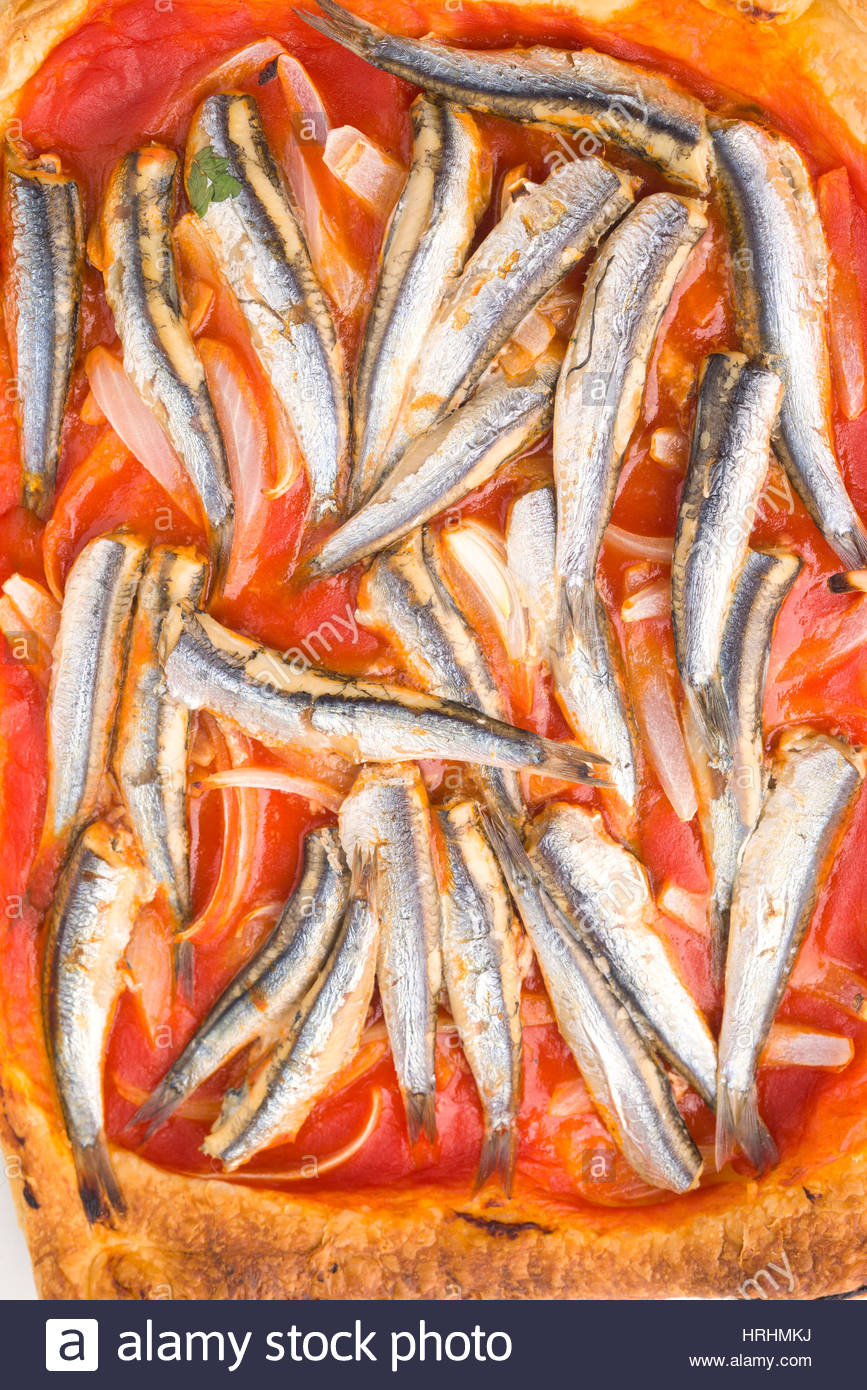 overhead approach shot of baked sardines on puff pastry homemade - Stock Image