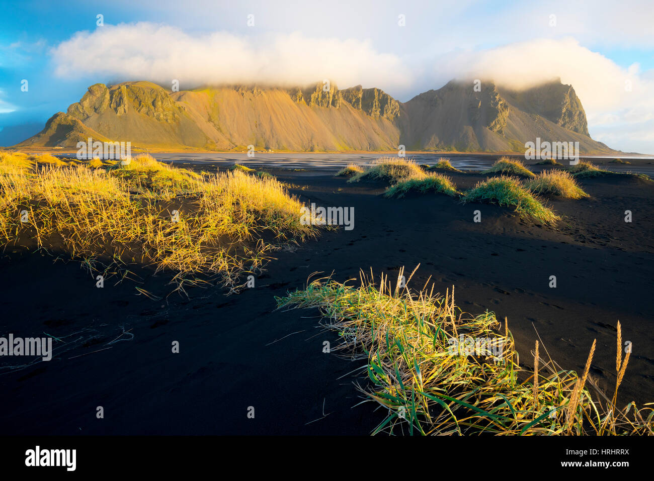 Mount Vestrahorn shrouded in clouds, Stokksnes, Iceland, Polar Regions - Stock Image