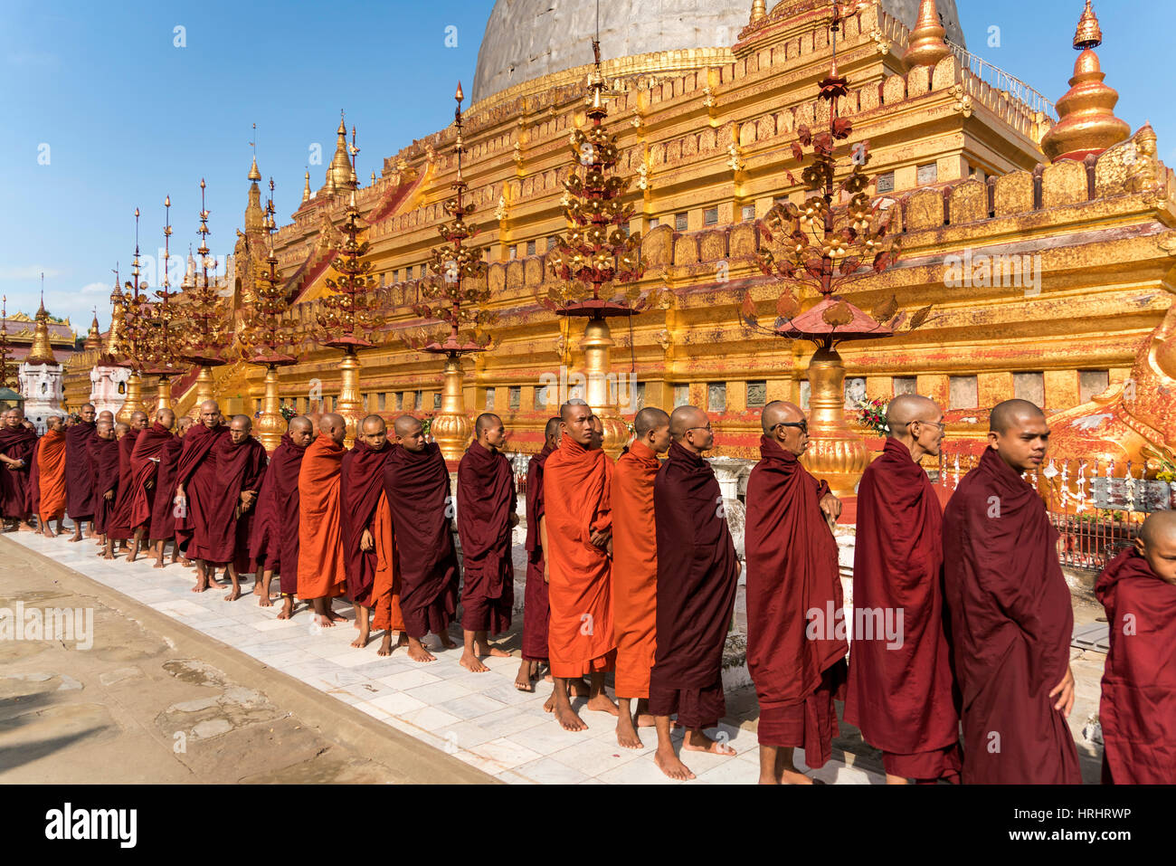 Monks at the Shwezigon Pagoda, Bagan (Pagan), Myanmar (Burma), Asia Stock Photo