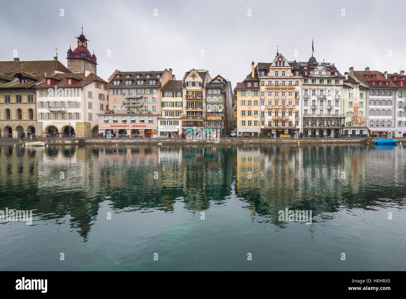 The typical buildings of the old medieval town are reflected in River Reuss, Lucerne, Switzerland - Stock Image