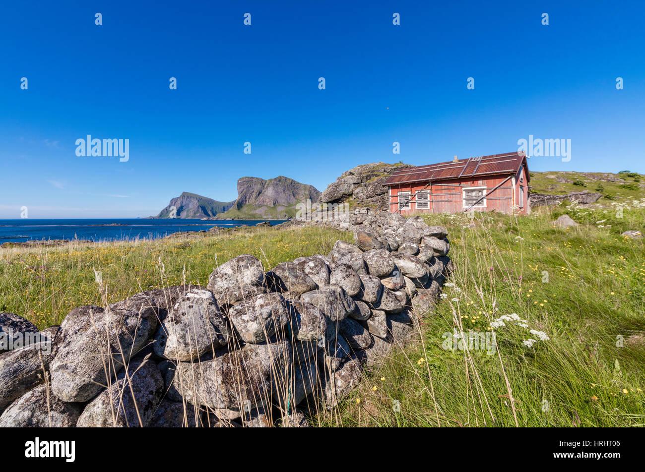 House of fishermen called rorbu surrounded by sea, Sorland, Vaeroy Island, Nordland county, Lofoten archipelago, - Stock Image