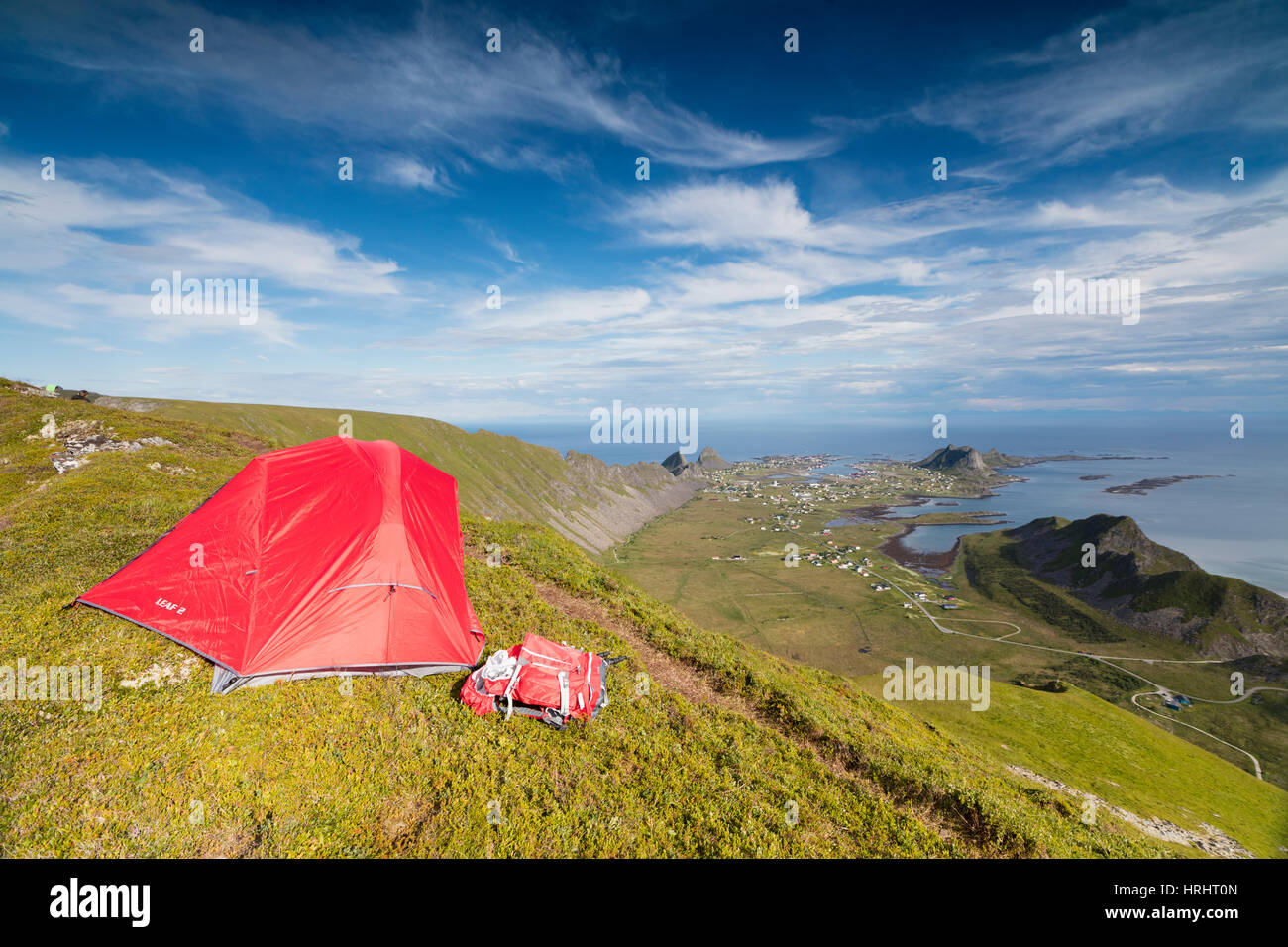 Tent on mountain ridge overlooking meadows and sea, Sorland, Vaeroy Island, Nordland county, Lofoten archipelago, - Stock Image