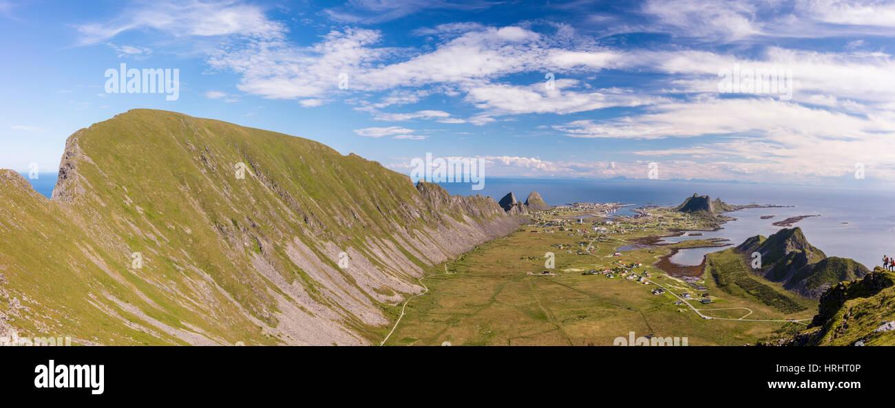 Mountain ridge frames the village of Sorland surrounded by sea, Vaeroy Island, Nordland county, Lofoten archipelago, - Stock Image