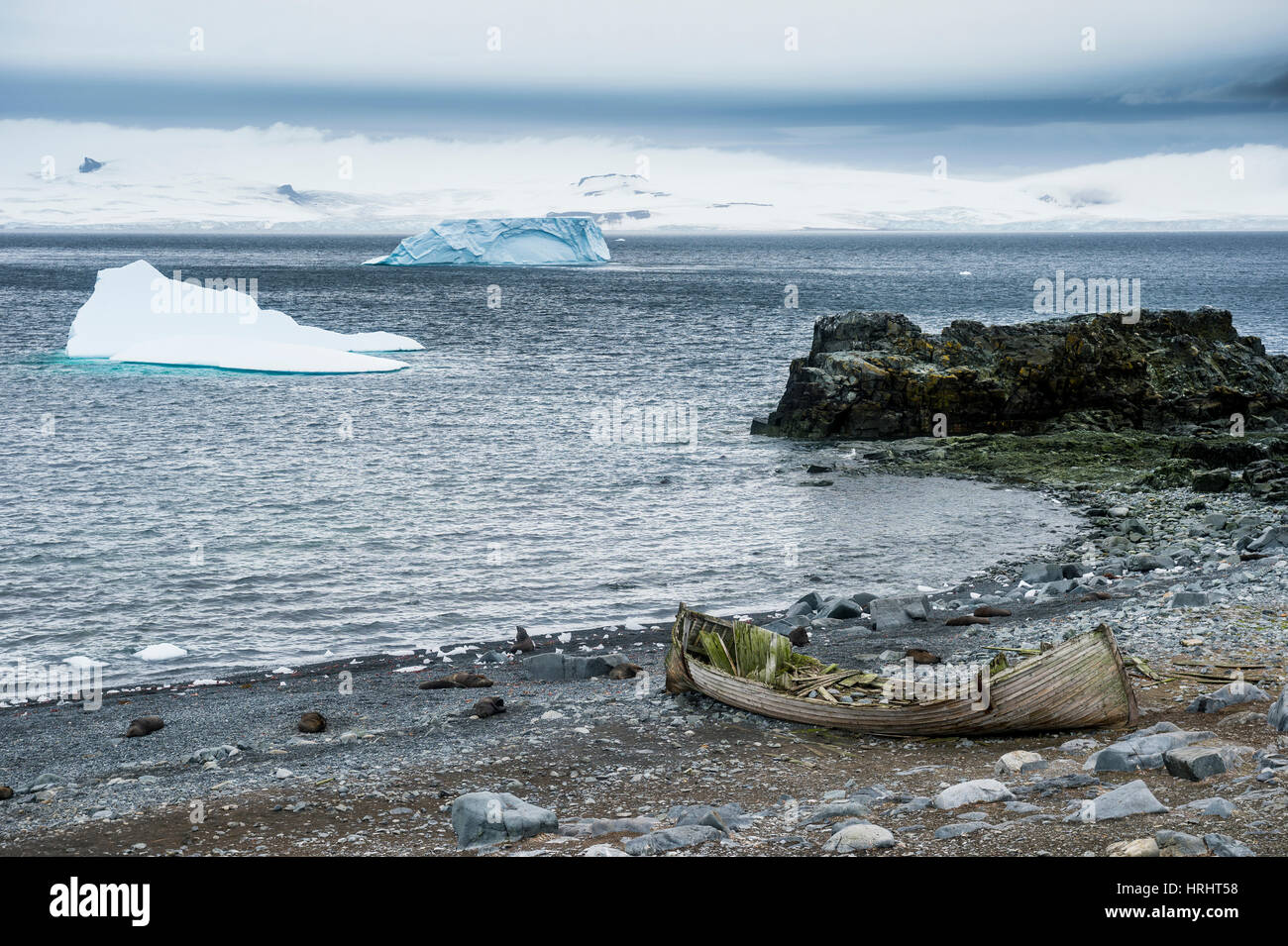 Old cargo boat on the shores of Half Moon Island, South Shetland Islands, Antarctica, Polar Regions - Stock Image