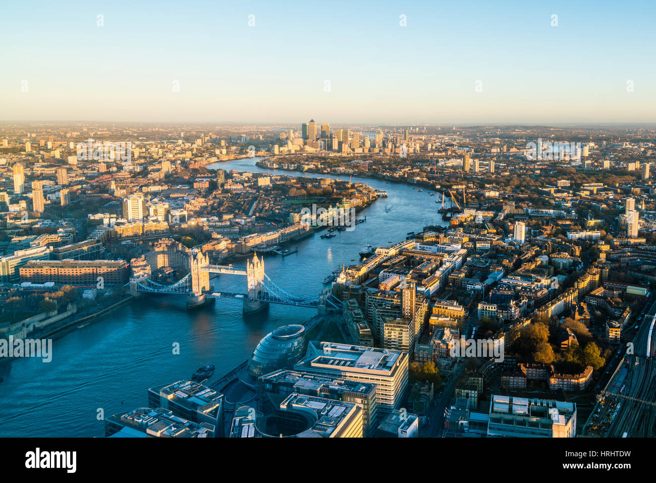 High view of London skyline along the River Thames from Tower Bridge to Canary Wharf, London, England, United Kingdom - Stock Image