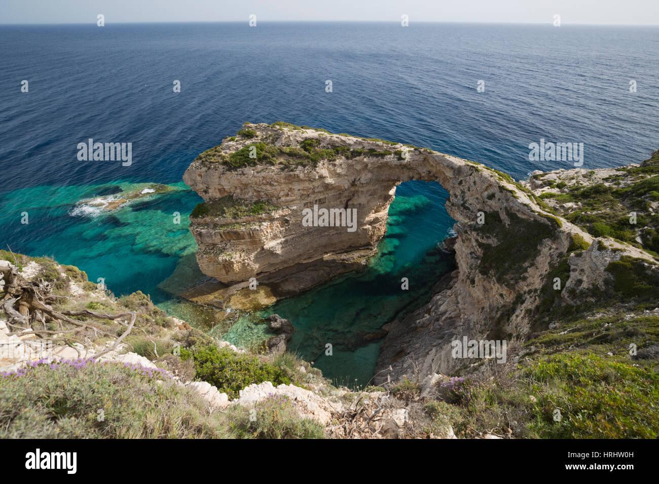 Trypitos Arch on west coast, Paxos, Ionian Islands, Greek Islands, Greece - Stock Image