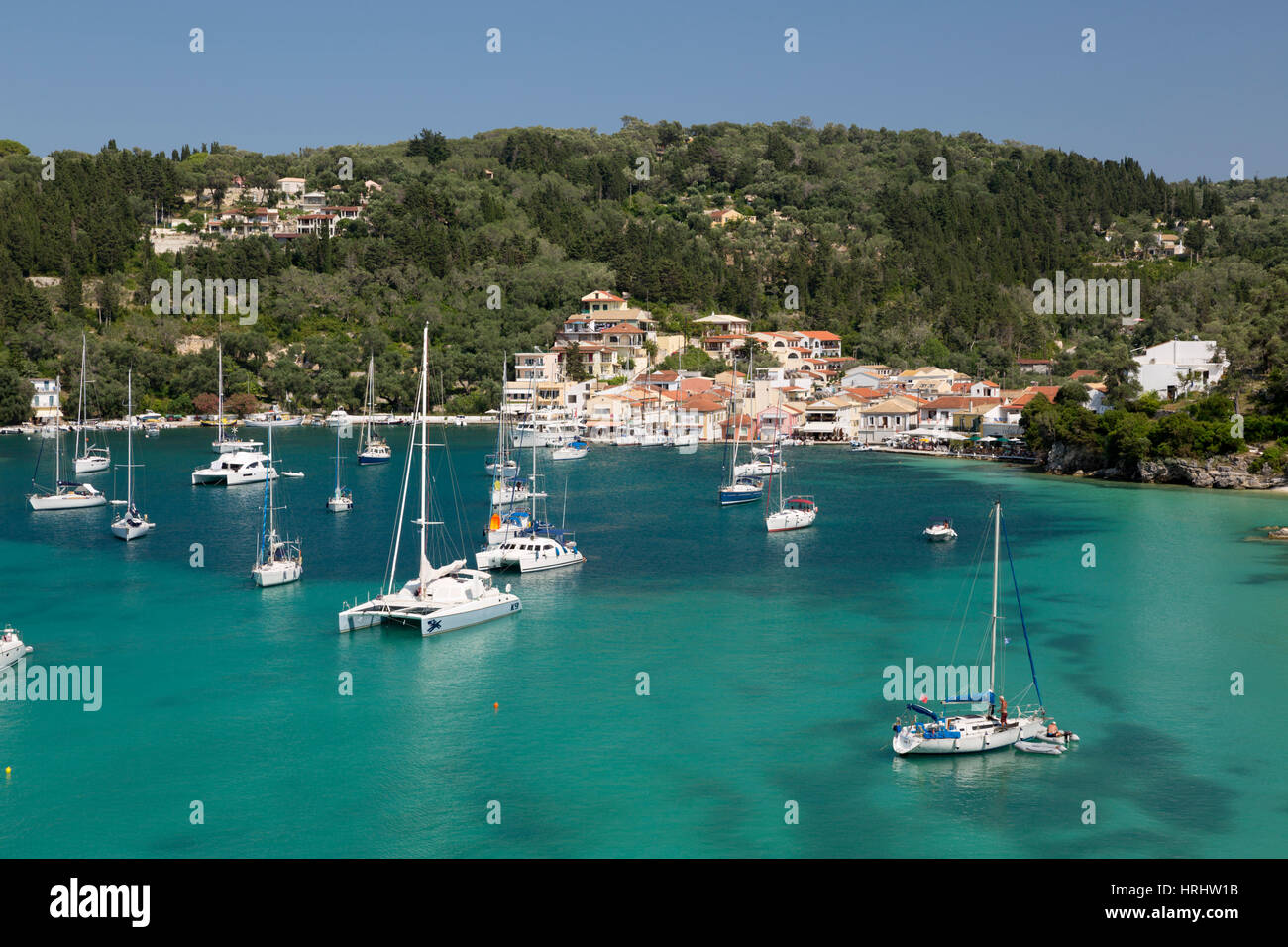 Yachts anchored in bay, Lakka, Paxos, Ionian Islands, Greek Islands, Greece - Stock Image