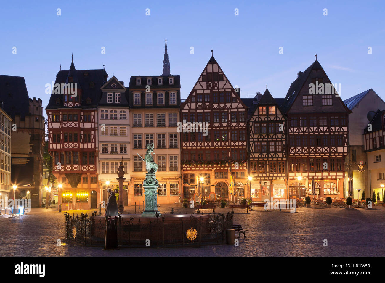 Half-timbered houses and Justitia Fountain at Roemerberg square, Frankfurt, Hesse, Germany - Stock Image