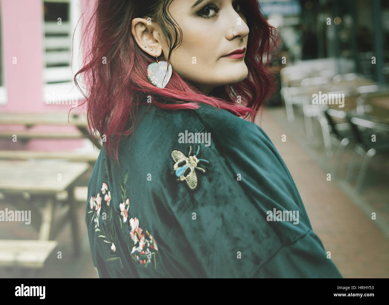 Woman with pink hair and brown eyes - Stock Image