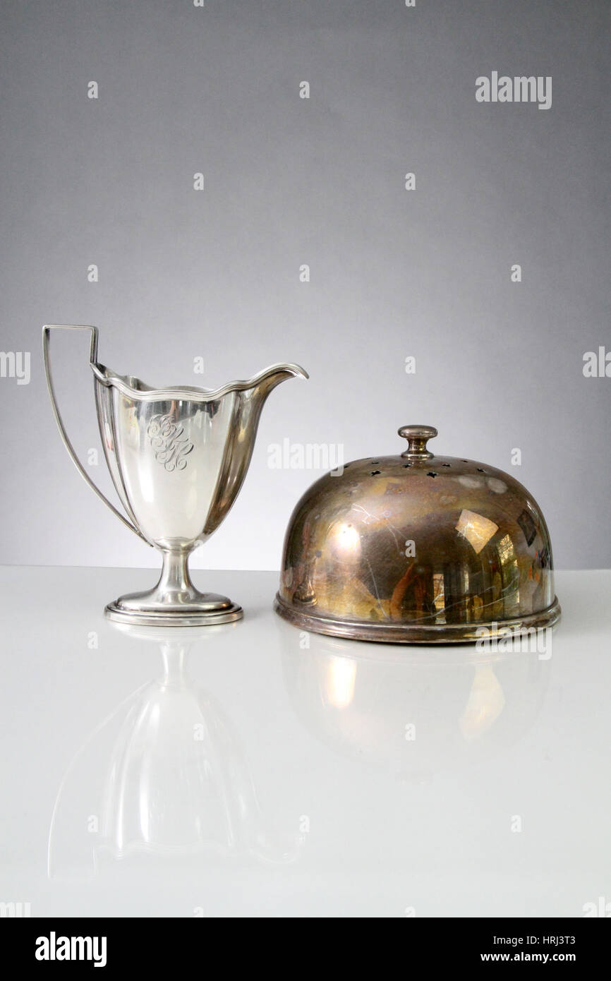 Polished Cup and Tarnished Cake Dome Stock Photo