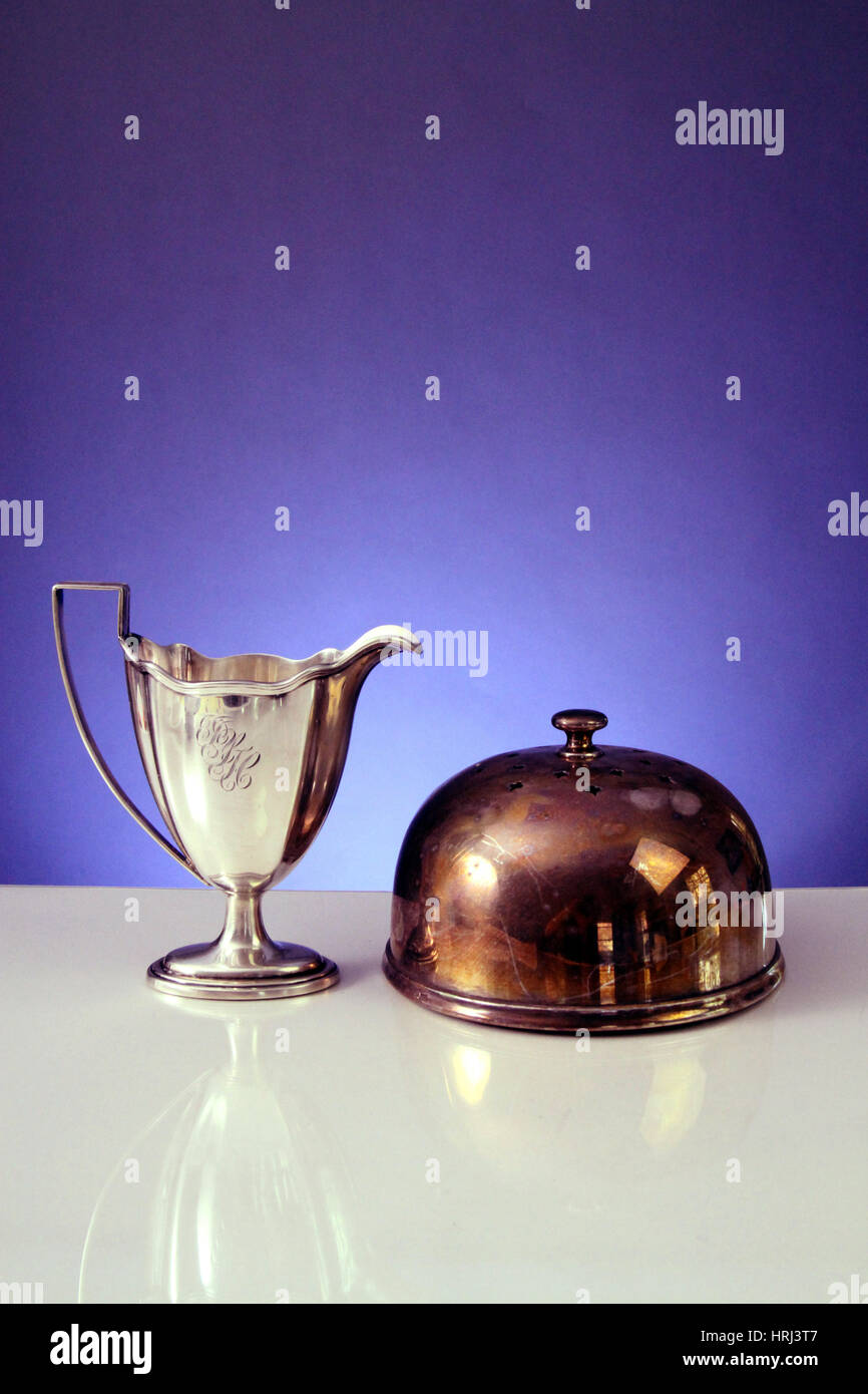 Polished Cup and Tarnished Cake Dome - Stock Image