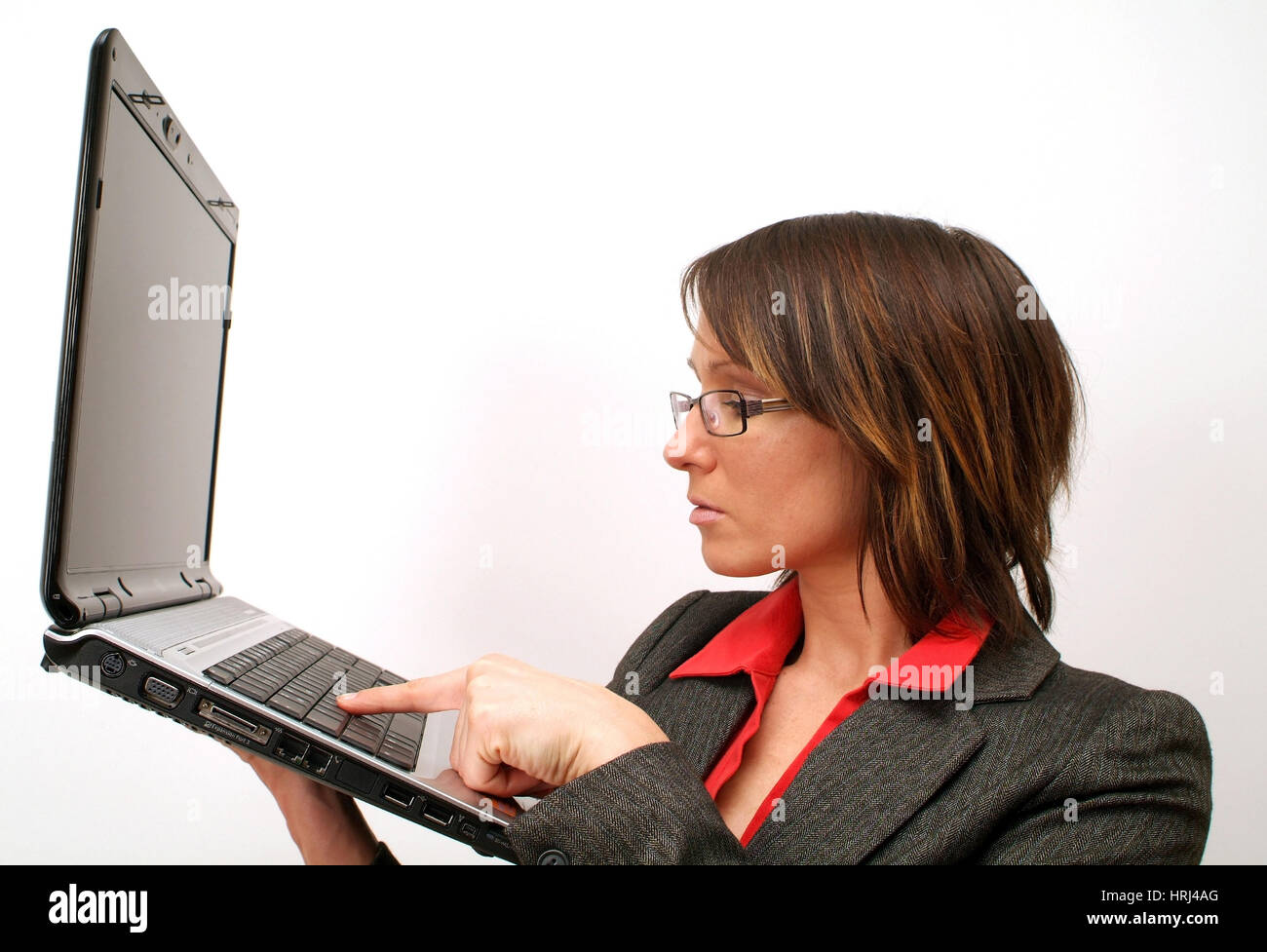 Junge Gesch?ftsfrau arbeitet am Notebook - young business woman using laptop Stock Photo