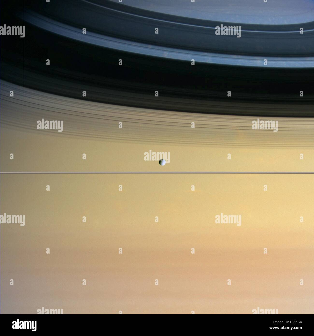 Saturn and its moon Dione - Stock Image