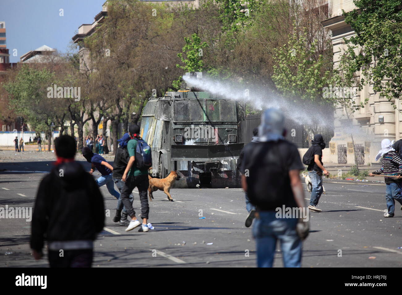 Chilean police water cannon disperse protesters,during a student strike in Santiago's Downtown, Chile. - Stock Image