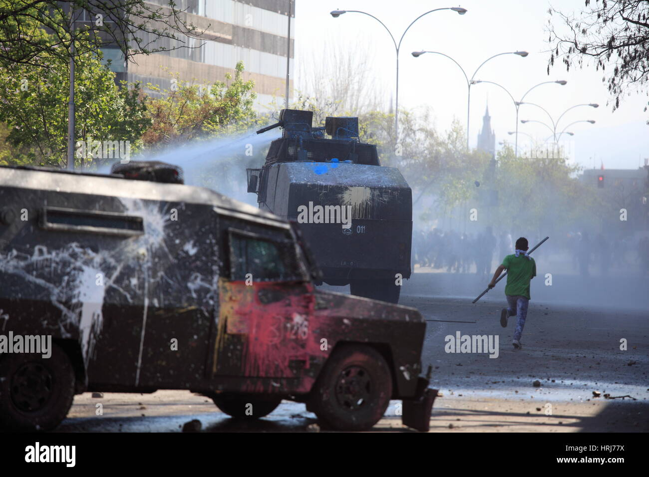 police water cannon disperse protesters,during a student strike in Santiago's Downtown, Chile. - Stock Image