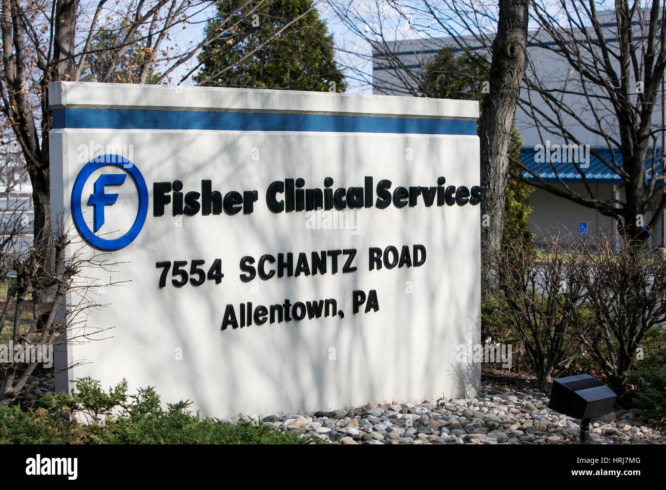 A logo sign outside of a facility occupied by Fisher Clinical Services in Allentown, Pennsylvania on February 26, - Stock Image