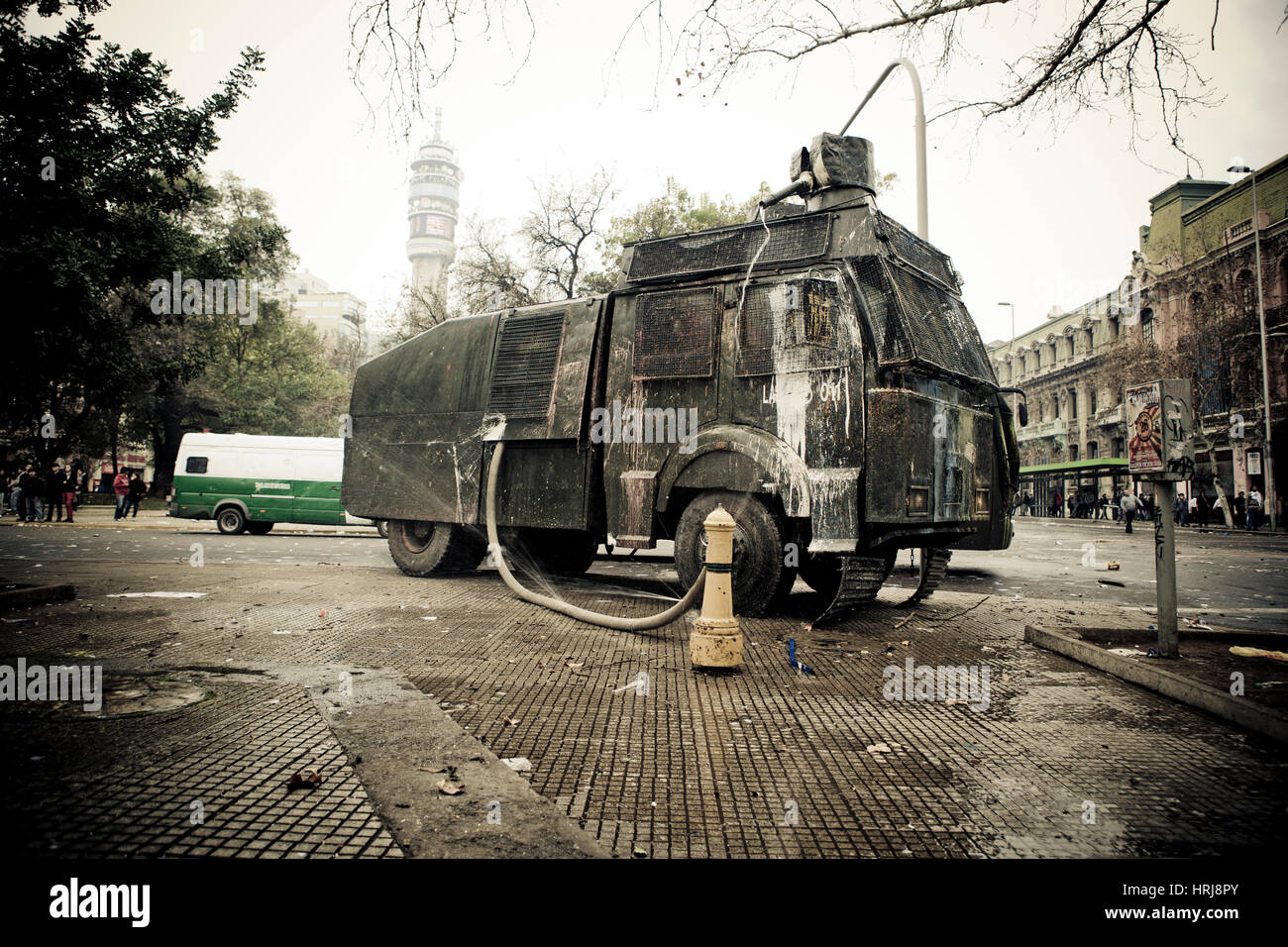 Chilean police water cannon on the street during a student strike in Santiago's Downtown, Chile. - Stock Image