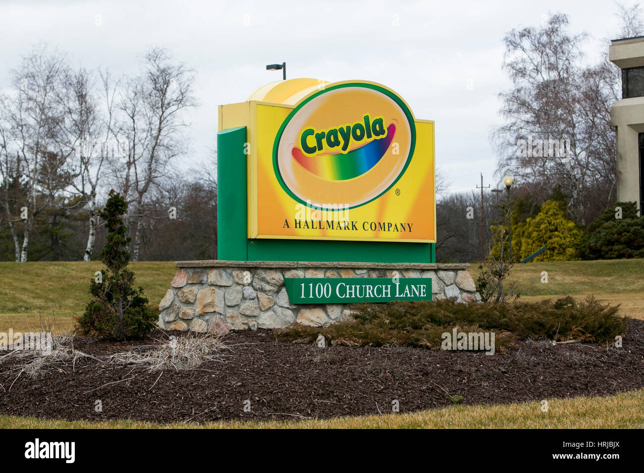 A logo sign outside of the headquarters of Crayola in Easton Stock ...