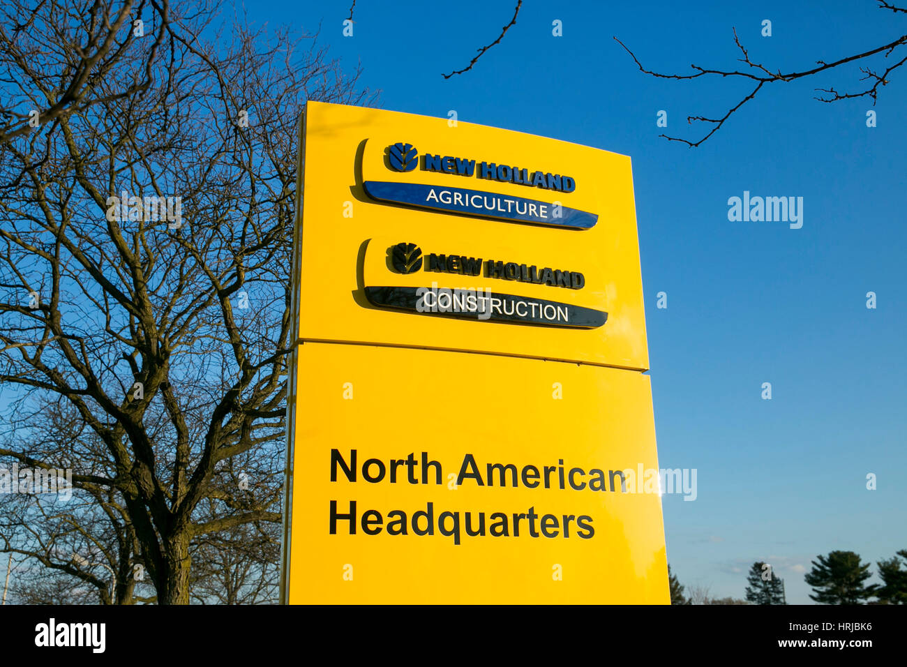 A logo sign outside of the North American headquarters of New Holland Agriculture in New Holland, Pennsylvania on - Stock Image