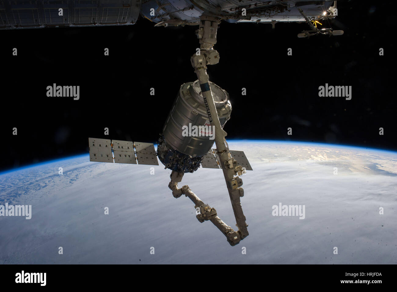 Cygnus Attached To Canadarm2 - Stock Image
