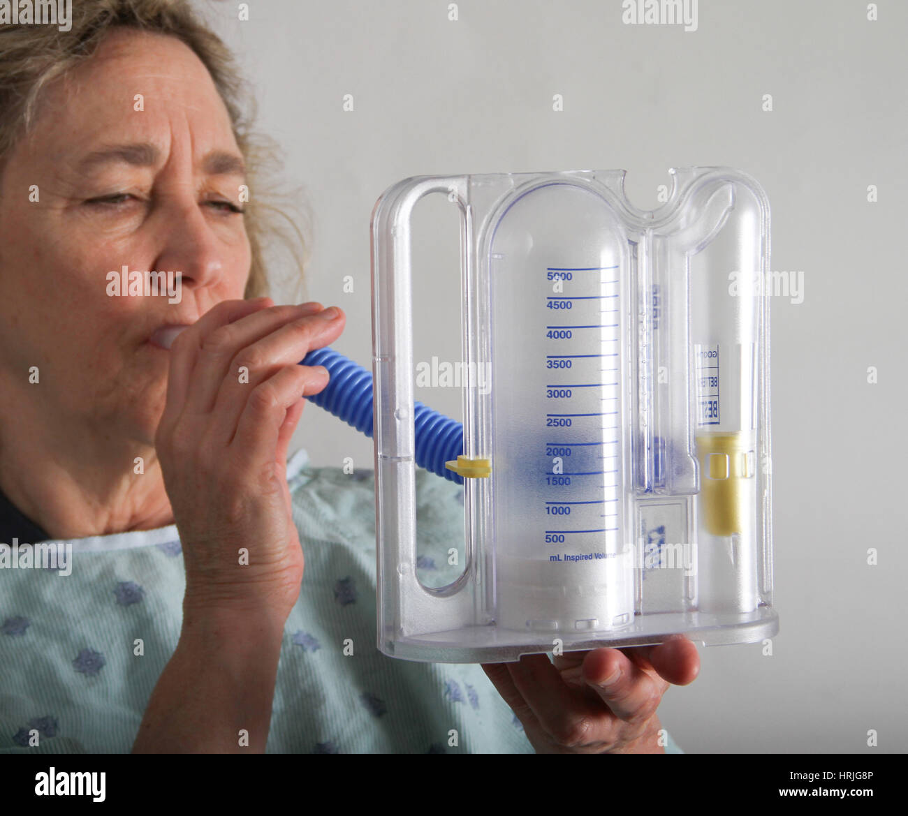 Woman doing a Spirometry Test - Stock Image