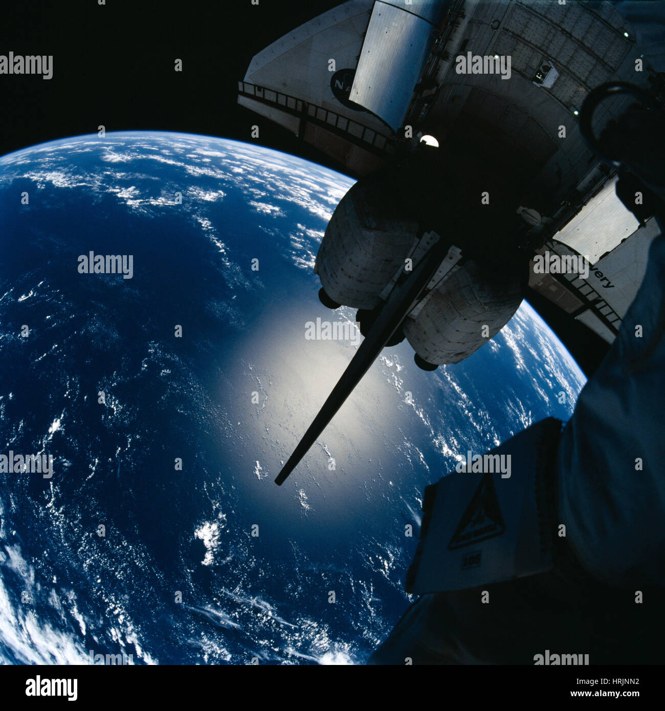 STS-105, Space Shuttle Discovery and Earth - Stock Image