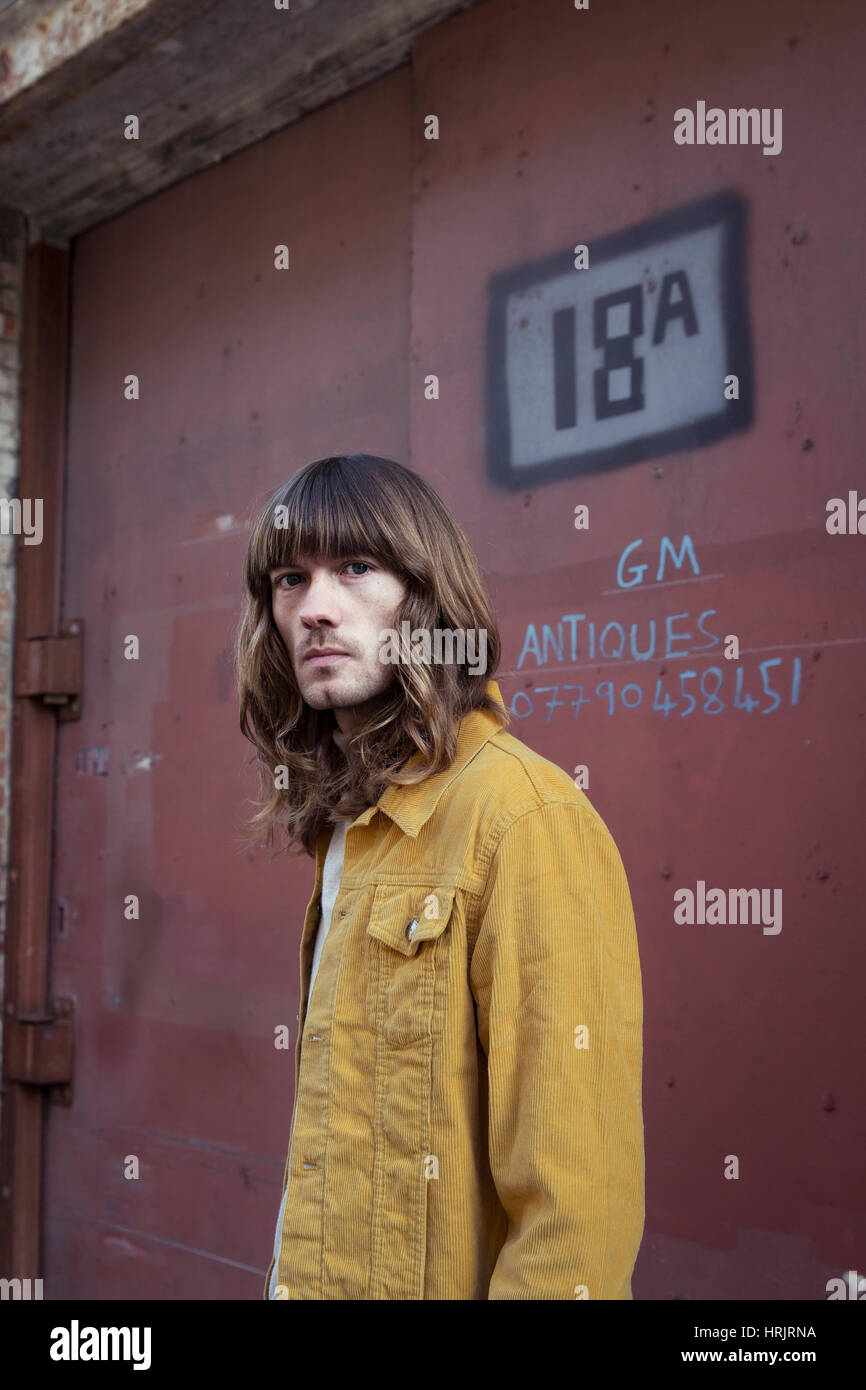 Male Model With Long Hair And 70 S Style Stock Photo Alamy