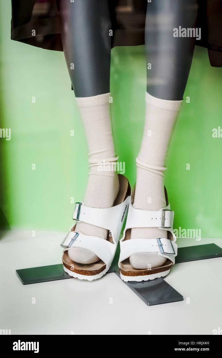 703c5cd41081e A shop window display of a pair of white Birkenstock sandals and socks. -  Stock