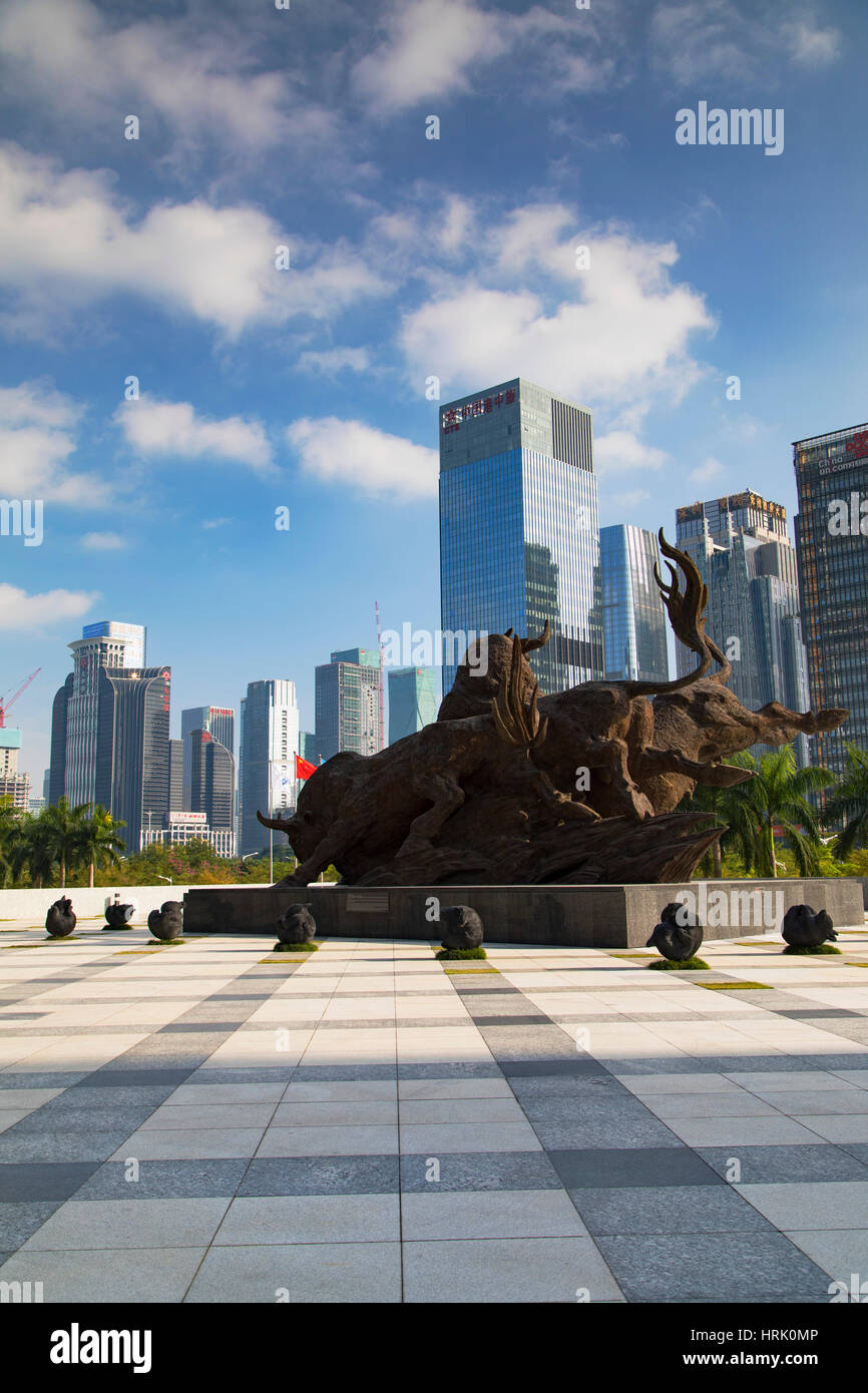 Skyscrapers and bull sculpture outside Shenzhen Stock Exchange, Futian, Shenzhen, Guangdong, China - Stock Image