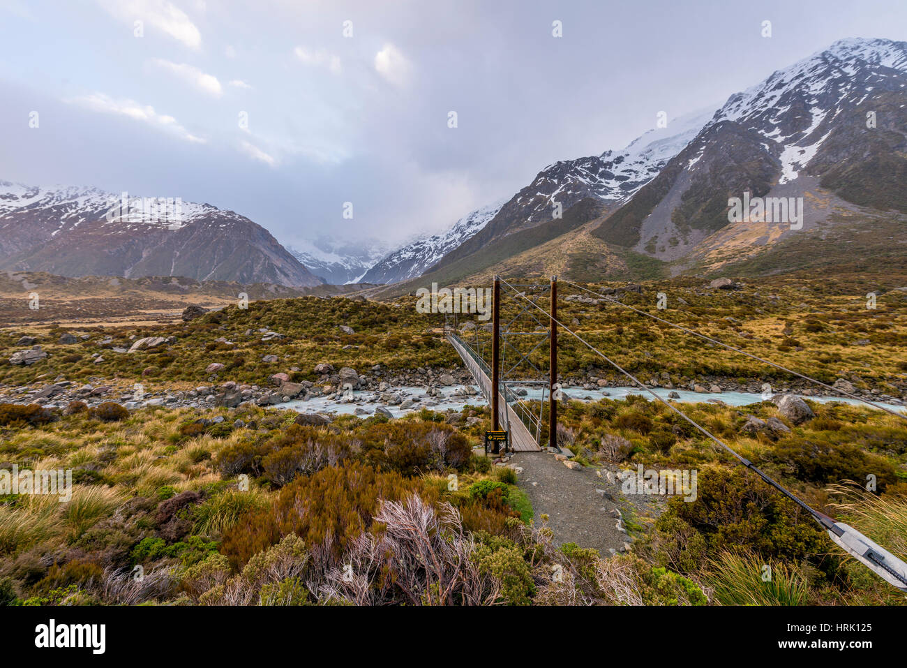 Bridge crosses Hooker River, Mountain, Mount Cook National Park, Canterbury Region, New Zealand - Stock Image