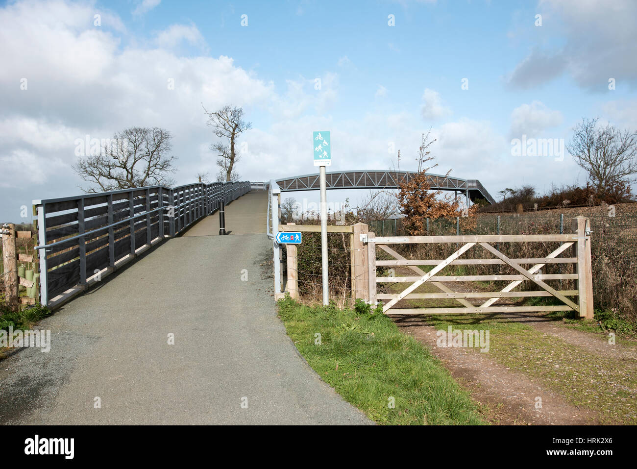 Cycleway and pedestrian footpath across rail lines to the Exe Estuary footpath near Starcross in South Devon England - Stock Image