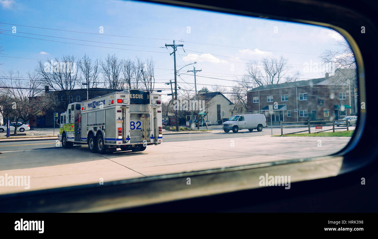 Watching a fire truck leave the station looking out of a window - Stock Image