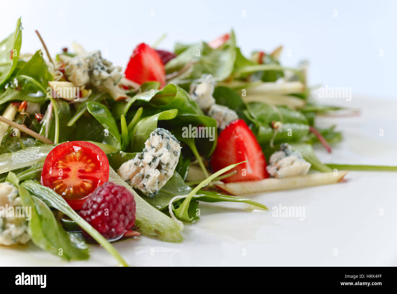 green salad with Gorgonzola and berries - Stock Image