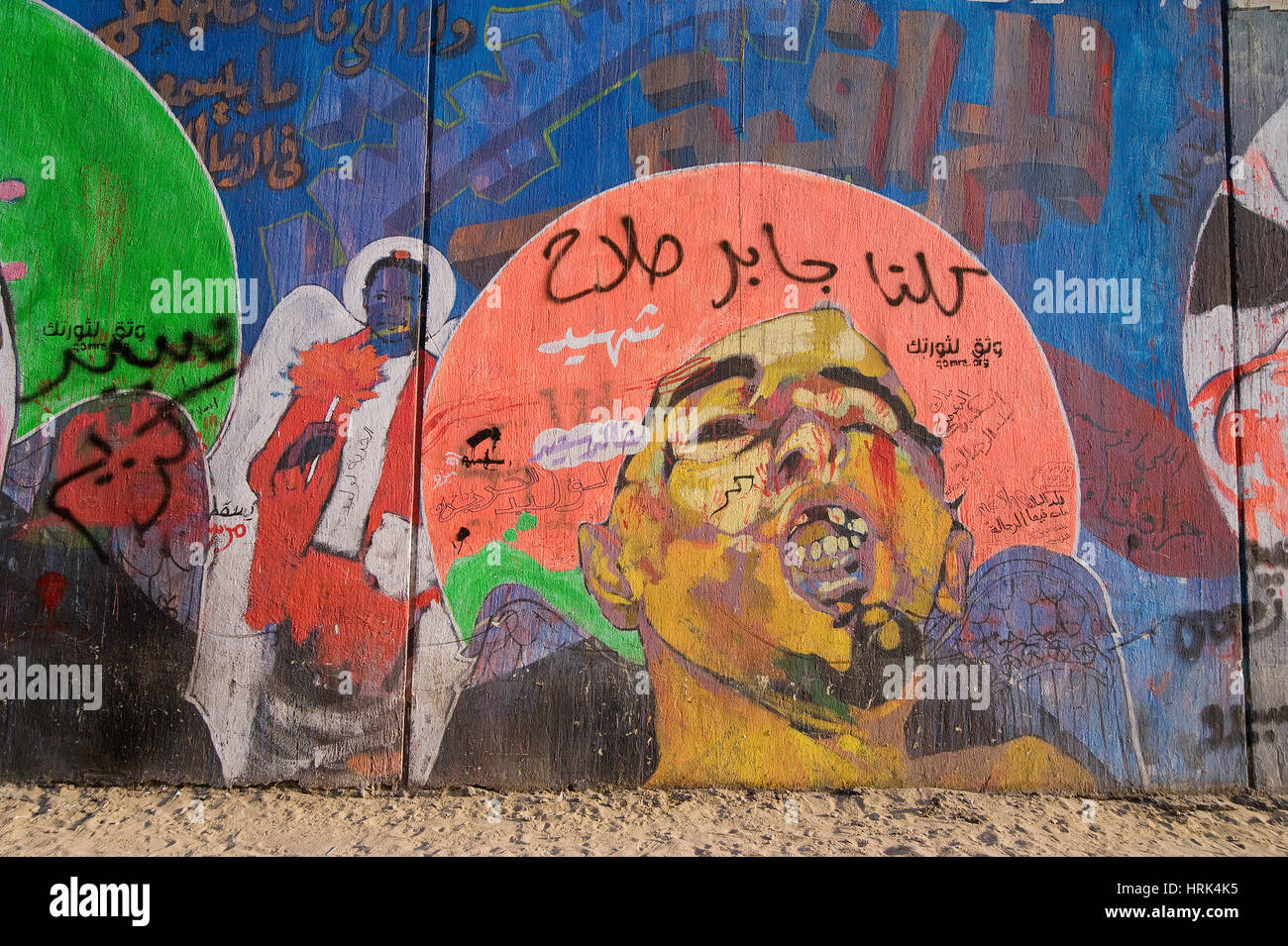 EGYPT, CAIRO: Ammar Abu Bakr is one of the most active mural artists. Here is drew martyrs as they looked after Stock Photo