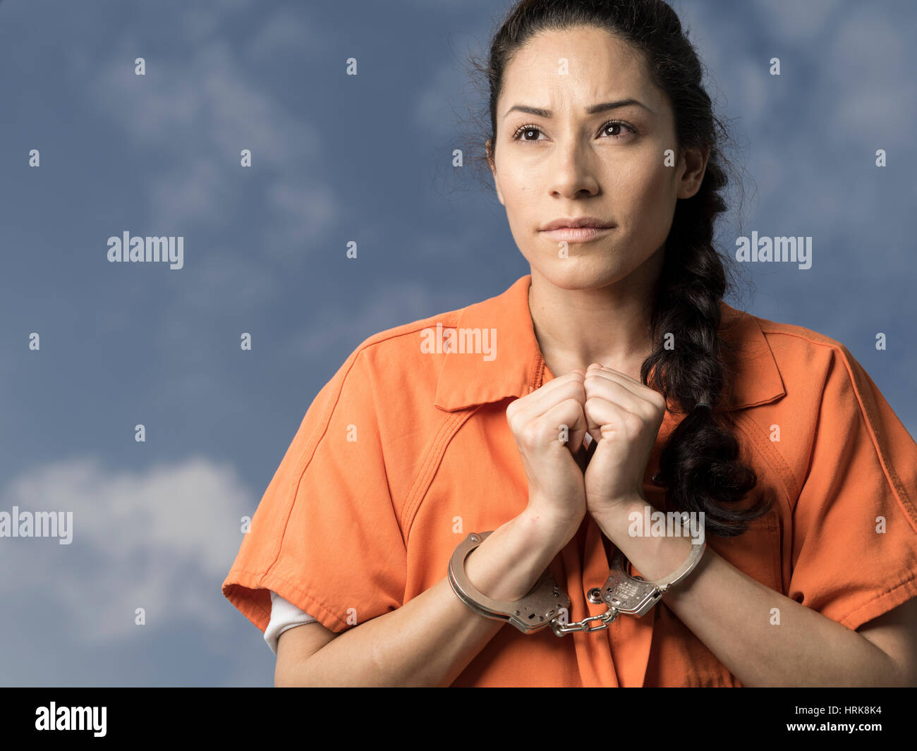 woman putting on prison uniform