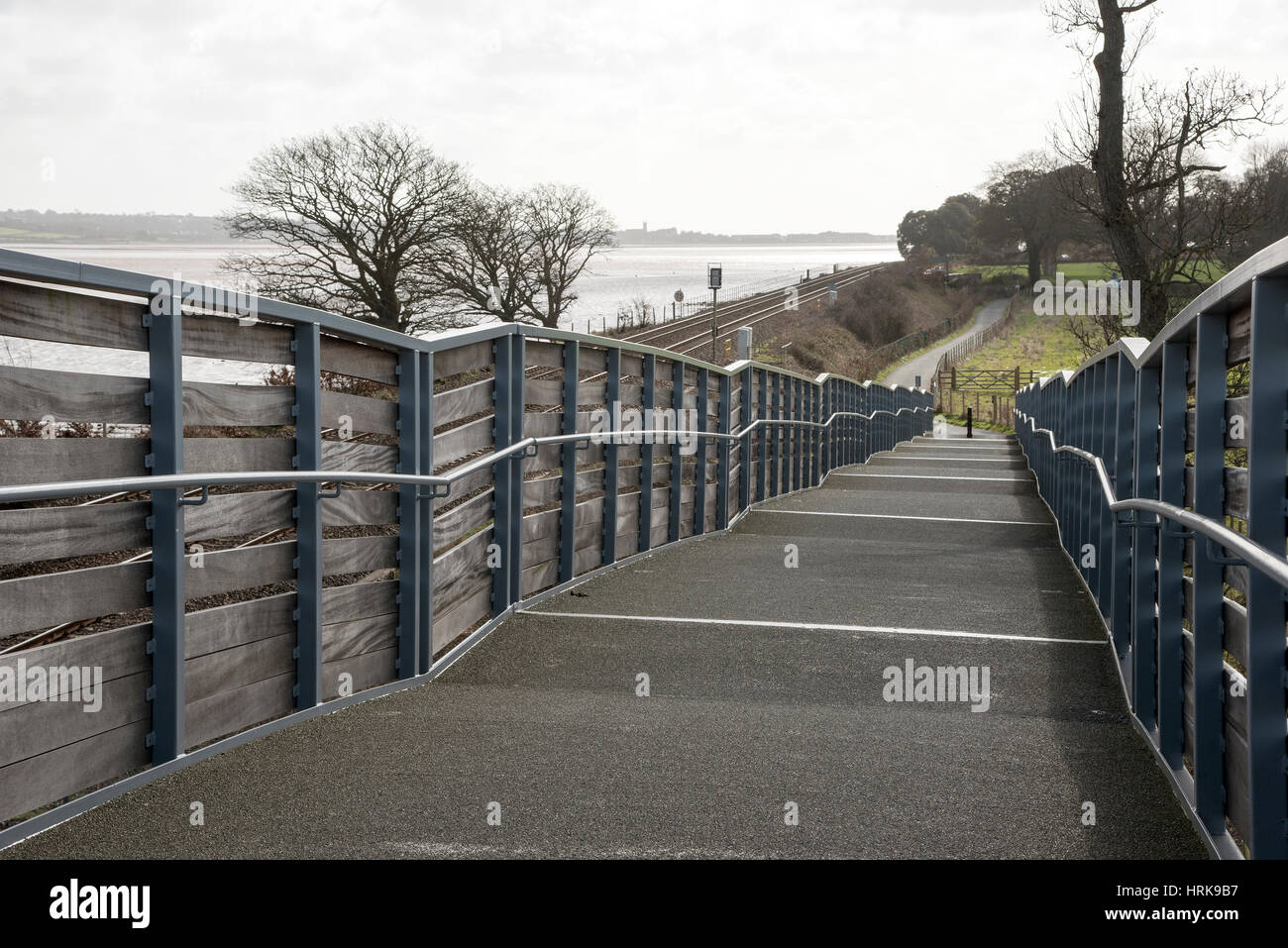Cycleway and pedestrian foothpath acrooss rail lines to the Exe Estuary footpath near Starcross in South devon England - Stock Image