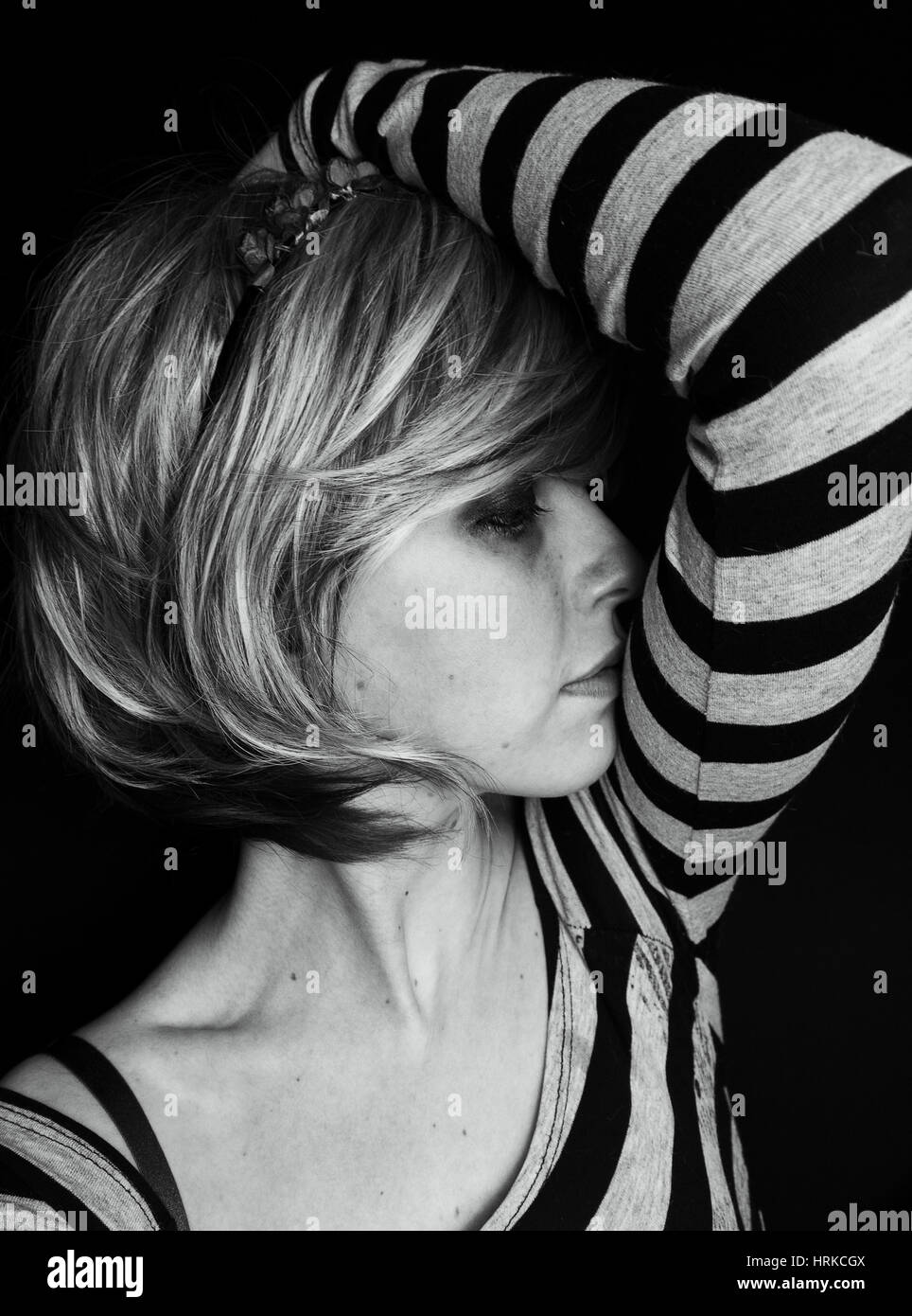 Dark portraits of a emo blond woman - Stock Image