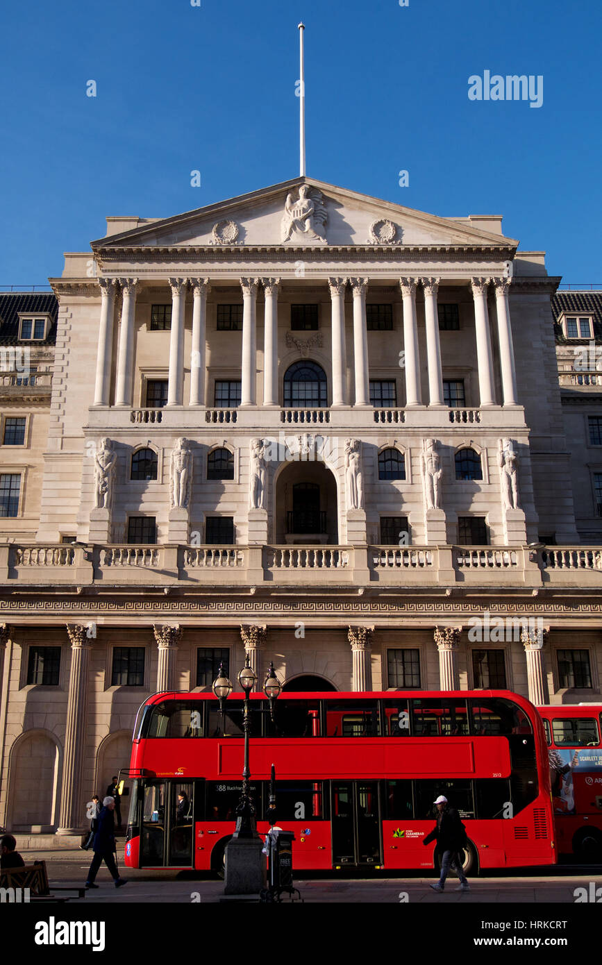 Red London Bus in front of the Bank of England, London, England - Stock Image
