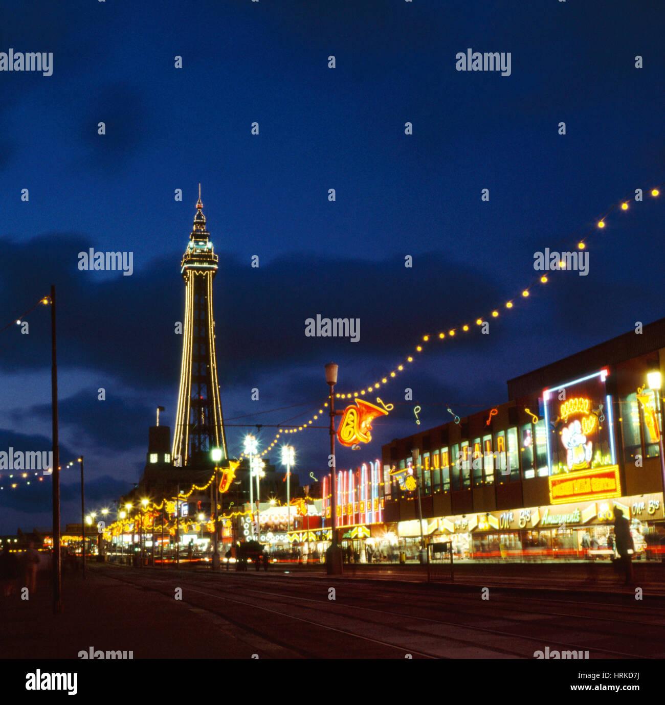 Blackpool Tower and the promenade at night, Lancashire, UK. - Stock Image