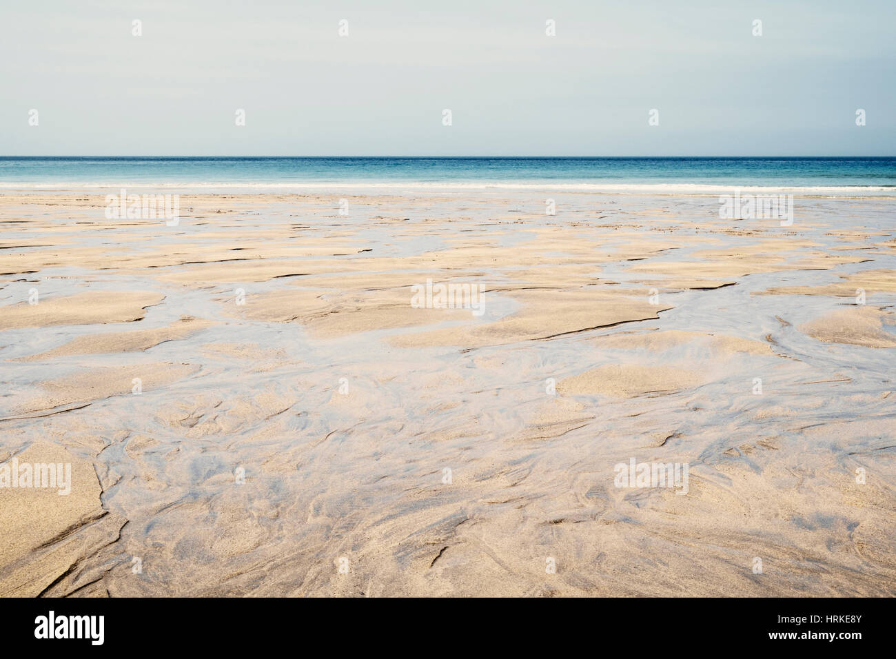 Empty sandy beach in Cornwall, England, UK on a summer day - Stock Image