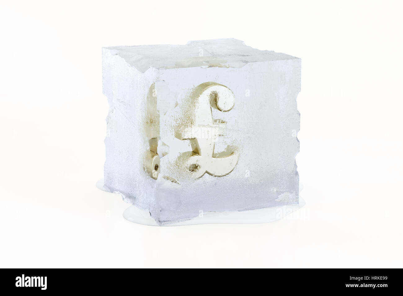 Golden British Pound Sterling concept symbol frozen in a slowly melting ice cube isolated on a white background - Stock Image
