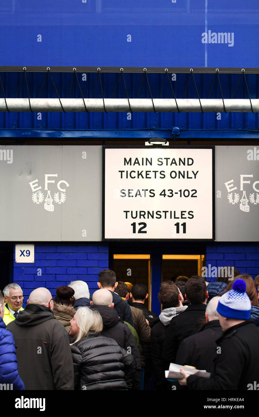 Everton supporters queuing up to get through the turnstiles at the recent home game against Sunderland at Goodison Stock Photo