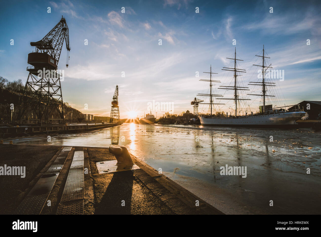 Cranes reminding of the shipbuilding history at the mouth of Aura river in Turku, Finland, February 2017 - Stock Image