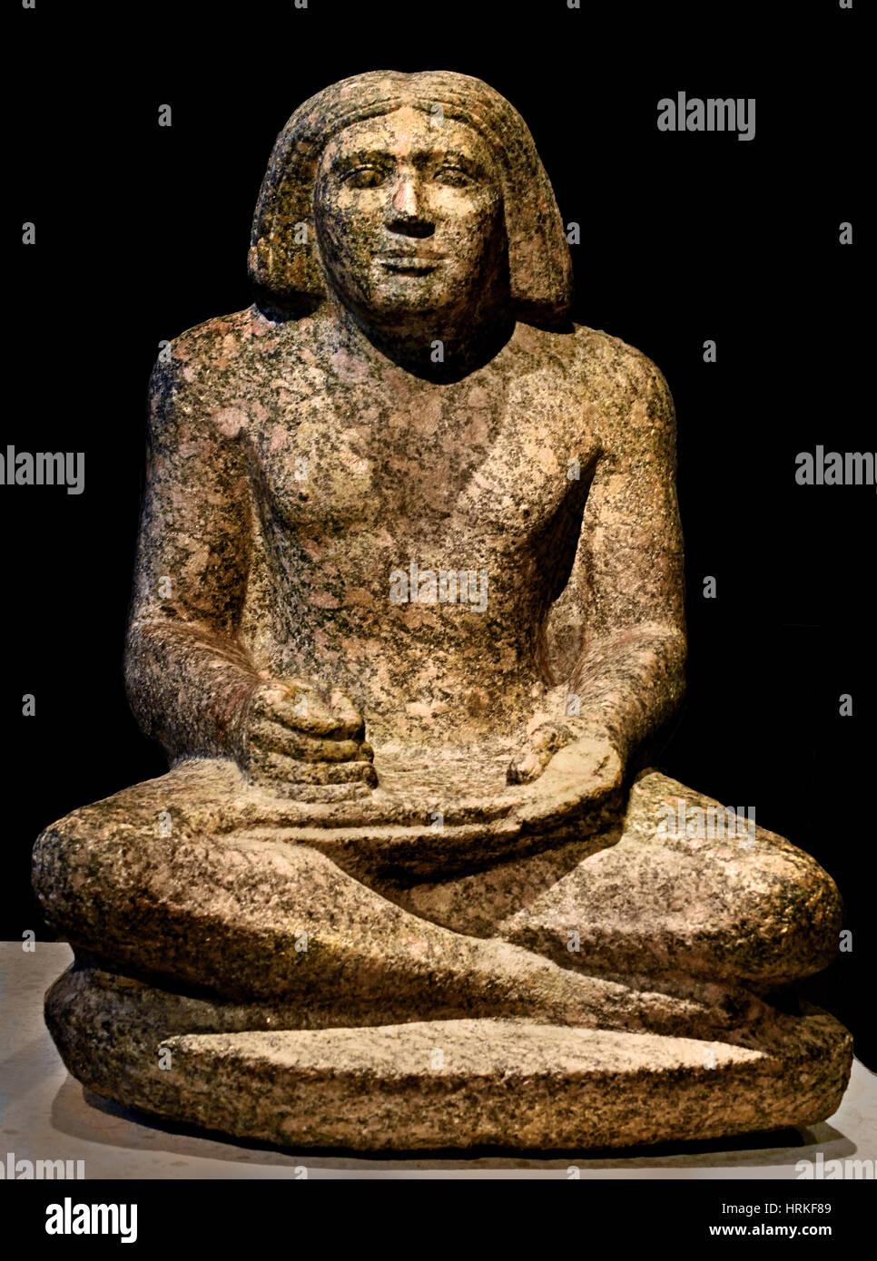 Scribe statue of the domain administrator Der-senedj 5th Dynasty Giza (Egypt / Lower Egypt) West CemeteryRosengranit - Stock Image