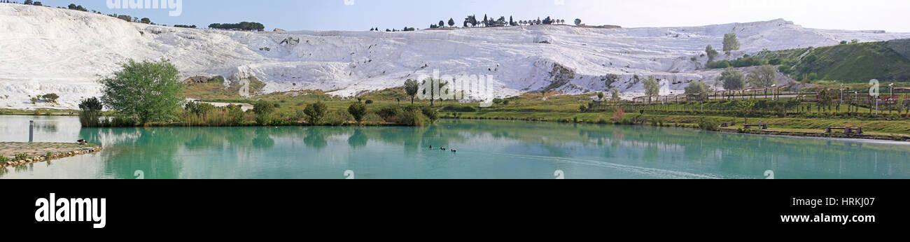 Panorama of lake and calcified limestone terraces, Pamukkale, Turkey - Stock Image