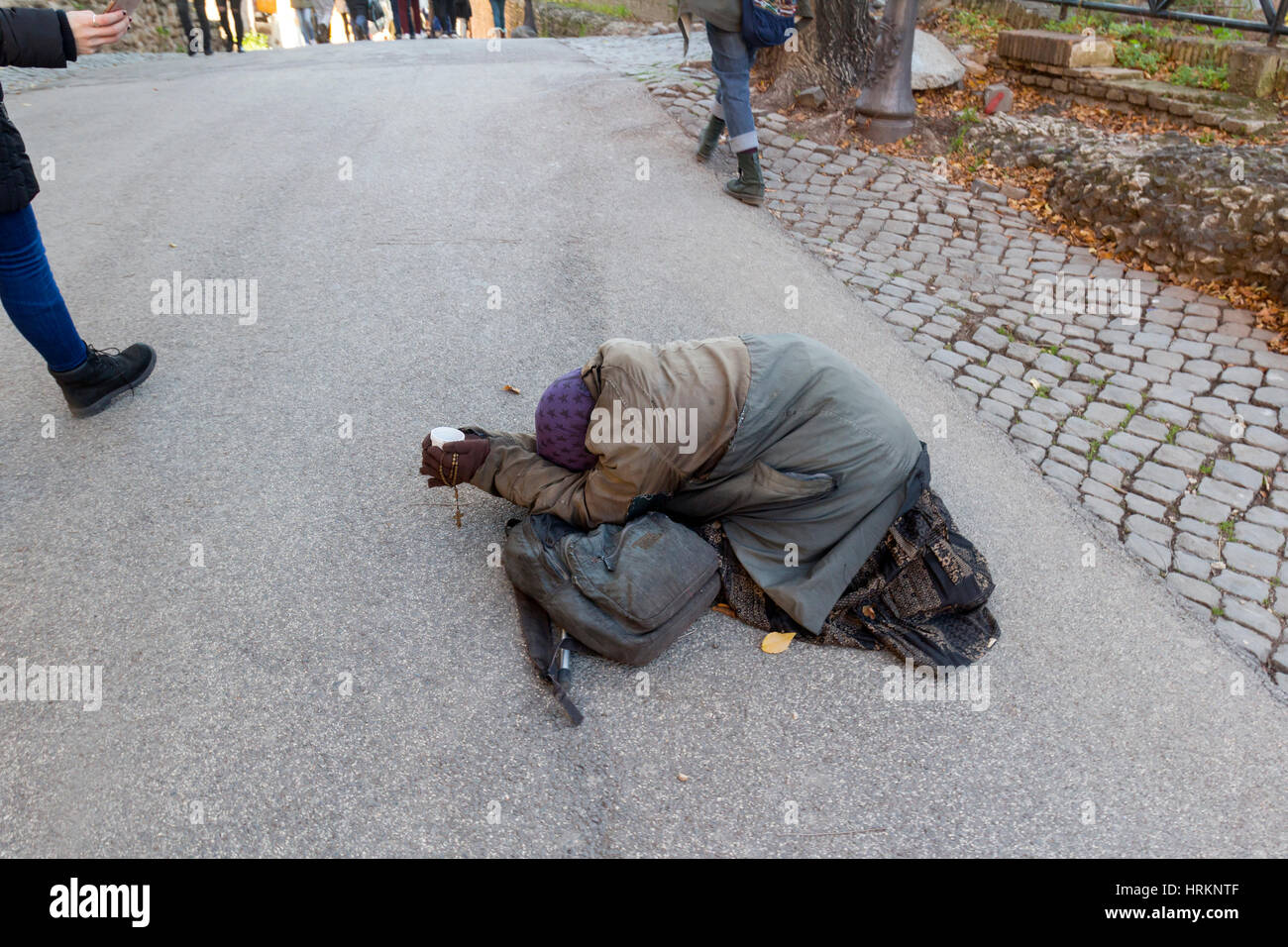 A beggar on the street in Rome, Italy. - Stock Image