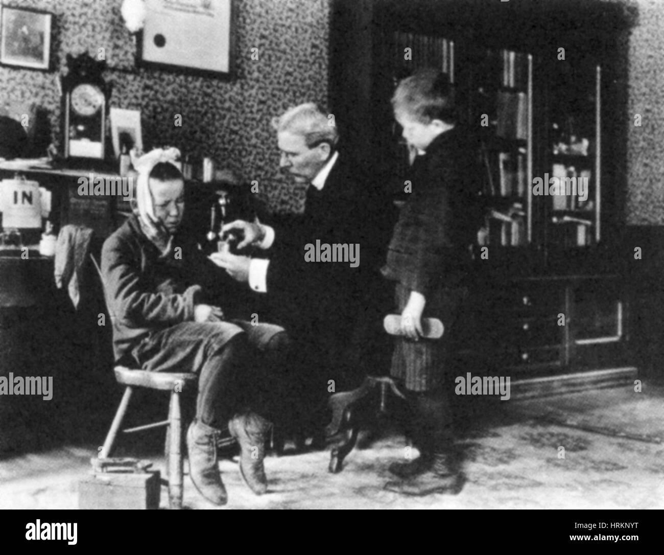 Doctor Treating Boy, 1900 - Stock Image