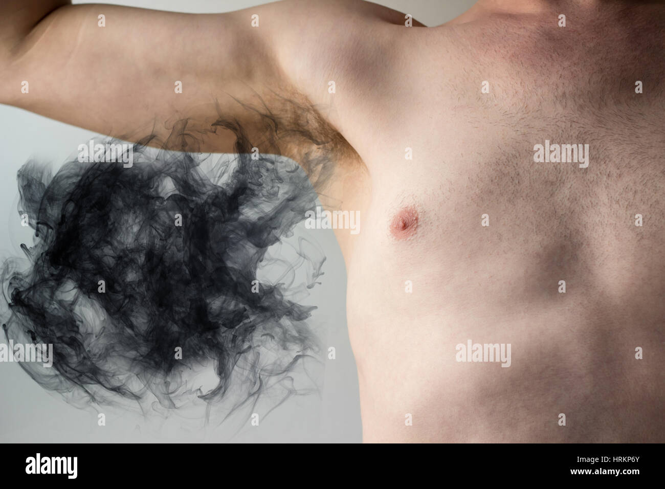 Plumes of smelly armpit body odor waft into the air - Stock Image