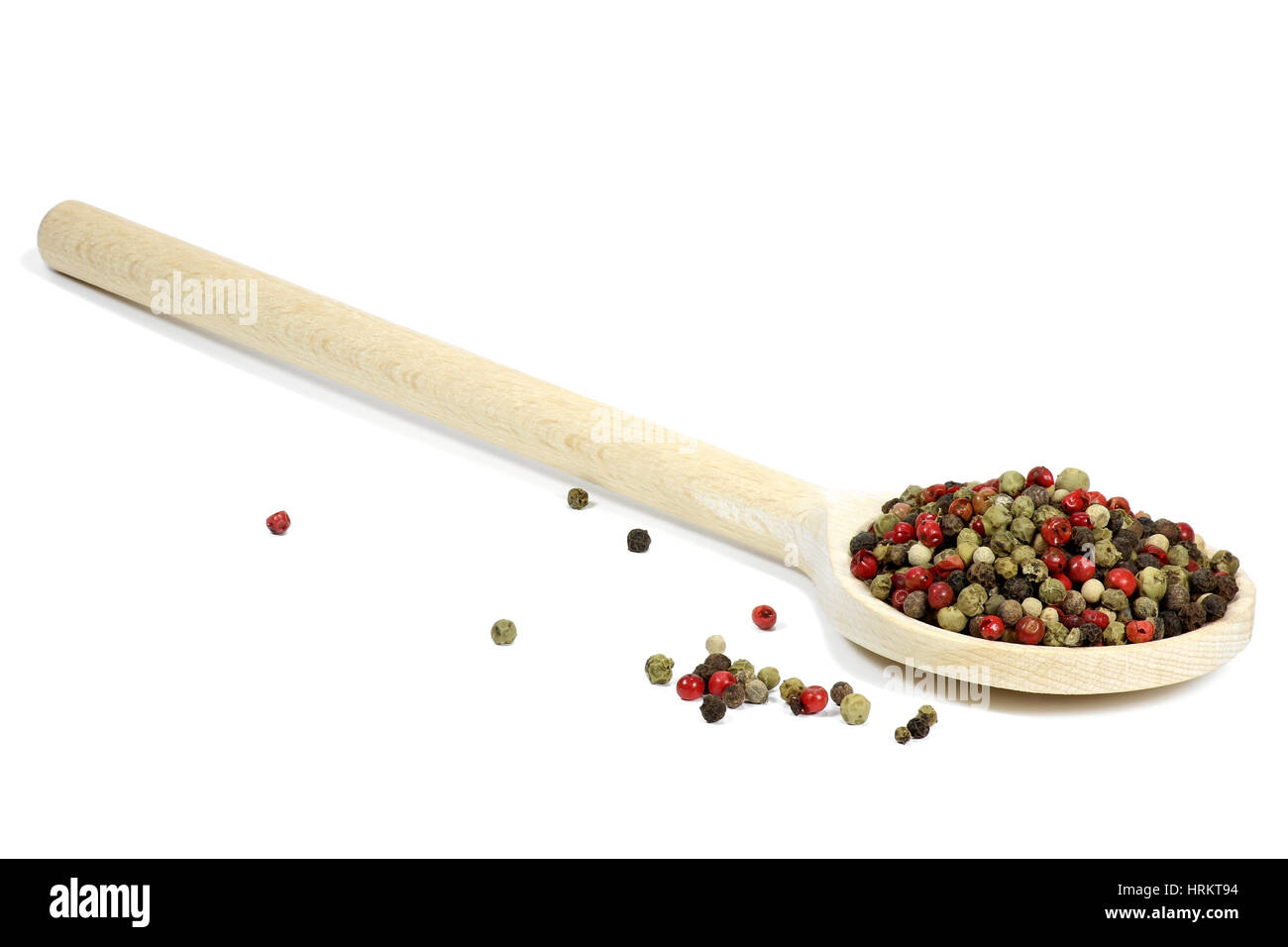 wooden spoon with mixed peppercorns isolated on white background - Stock Image
