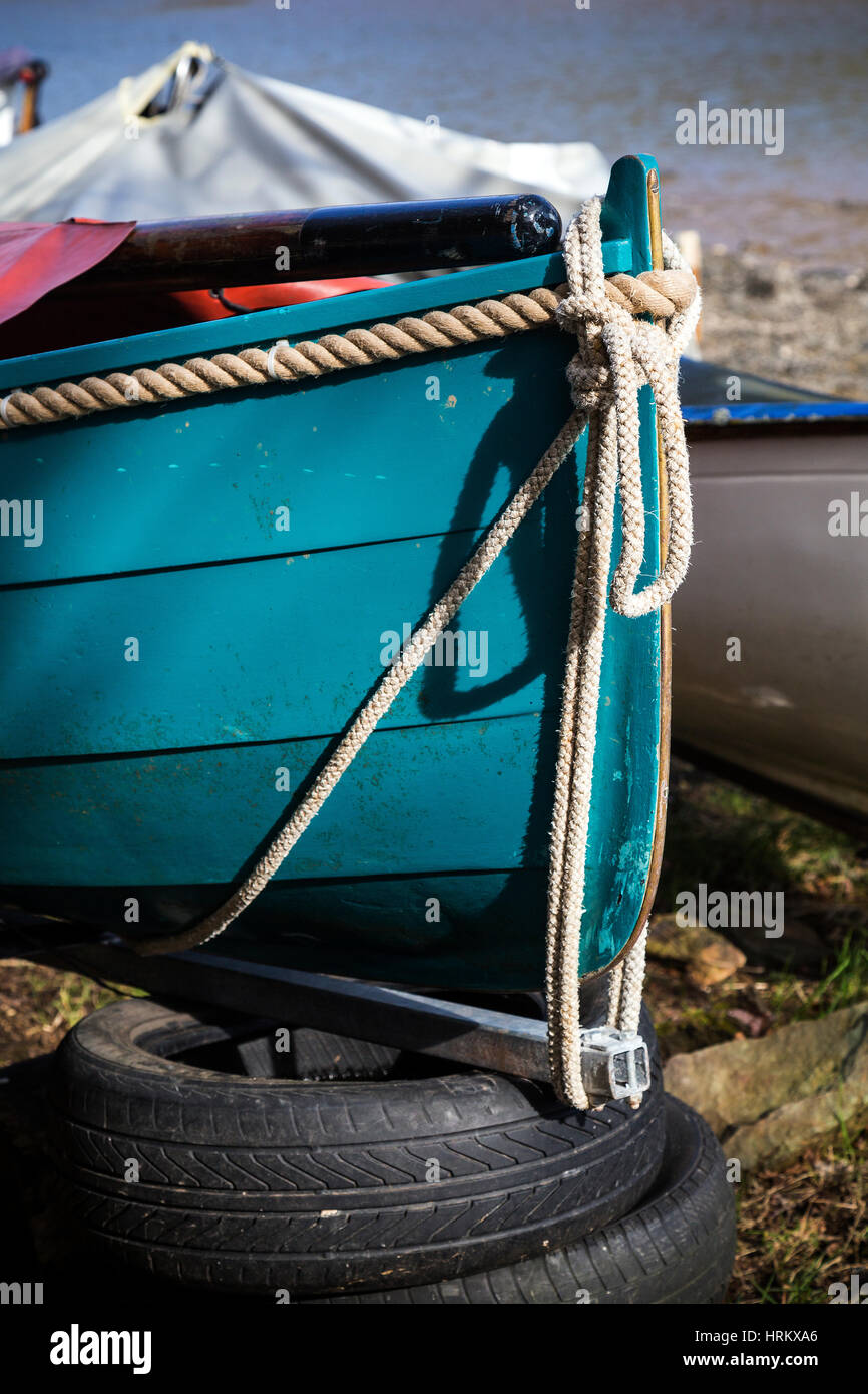 Boats on a creek on the river Dart the Devon village of Stoke Gabriel South Hams Devon,beached, blue, boat, bold, - Stock Image